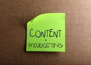 Content + marketing written on sticky note