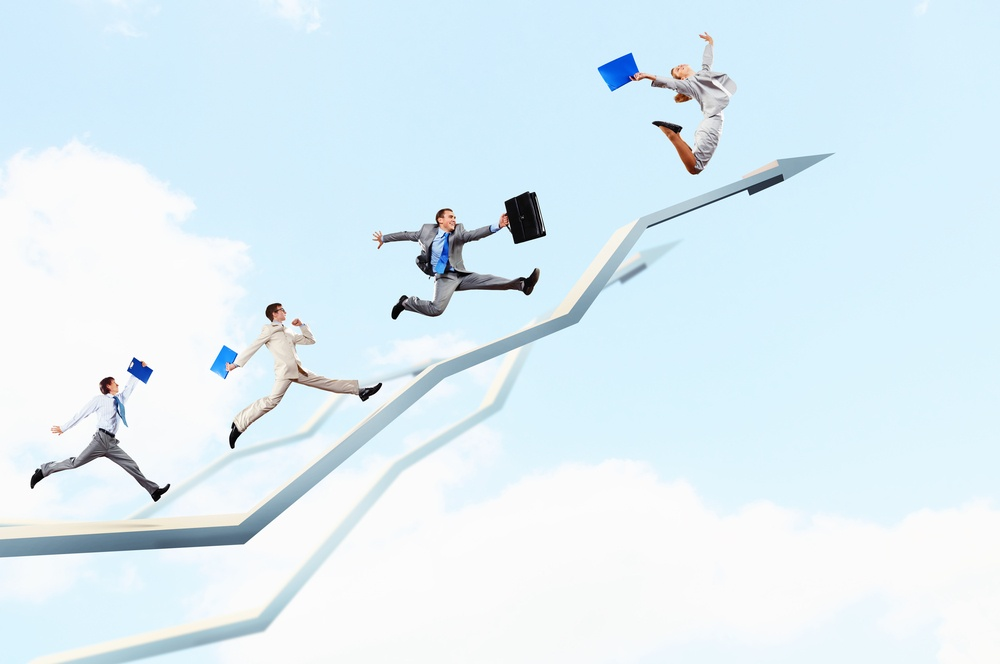 Sales people running up graph to convey success