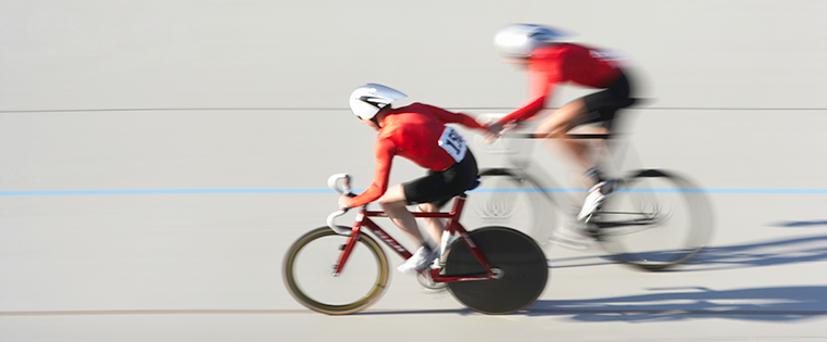 Two cyclist partners representing the relationship between sales and marketing